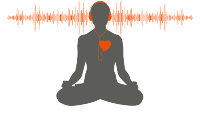 Person in lotus position, meditating using earphones and audios