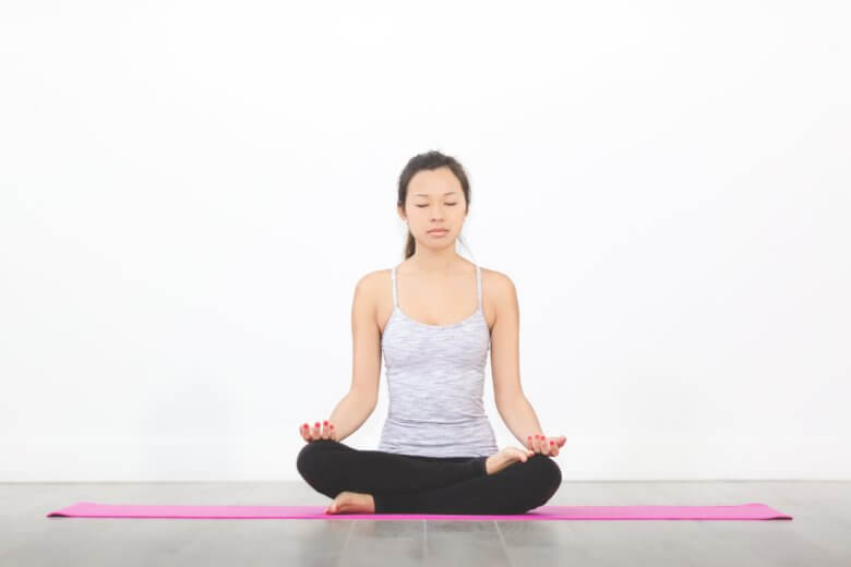 woman meditating hip open